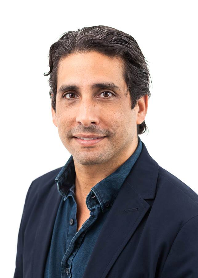 Headshot of young actor and businessman