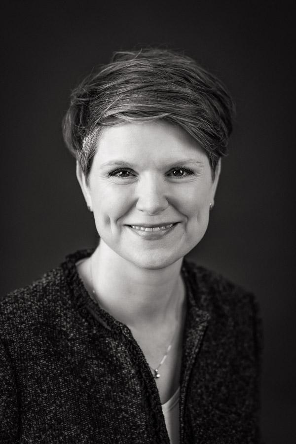 Black and white headshot of woman