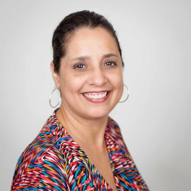 Headshot of woman with colourful blouse
