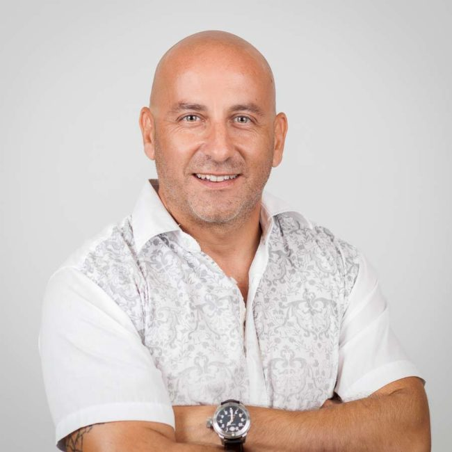 Headshot of male entrepreneur with crossed arms