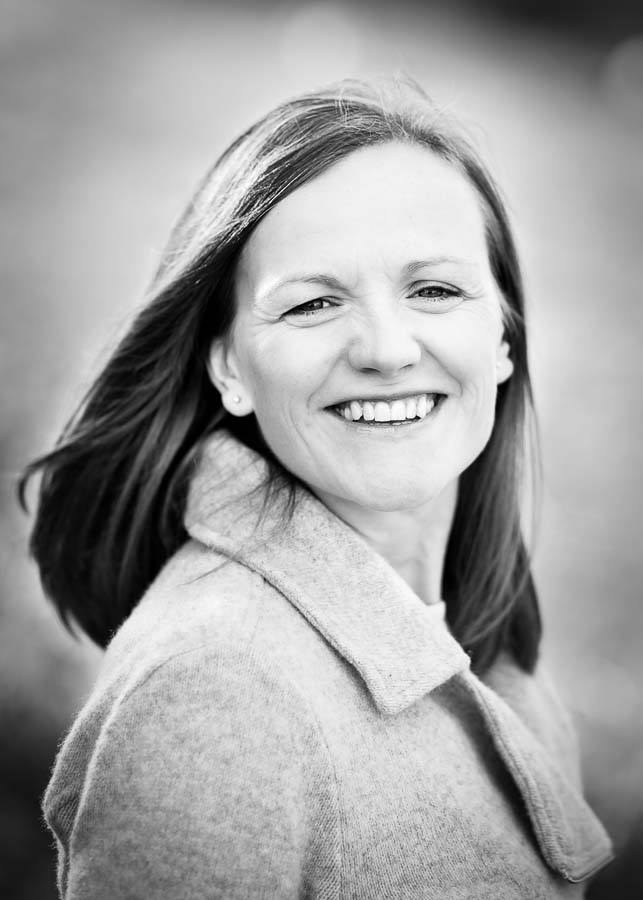 Outdoor black and white headshot of woman