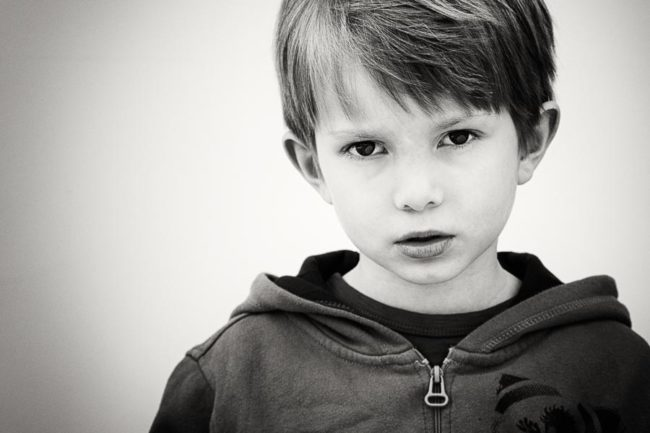Serious boy portrait in black and white