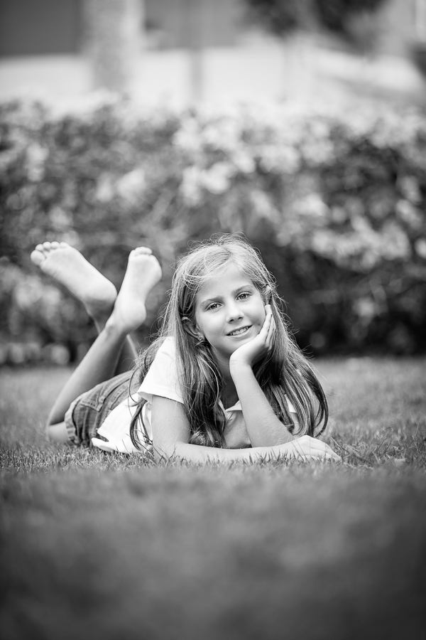 Girl on grass in black and white