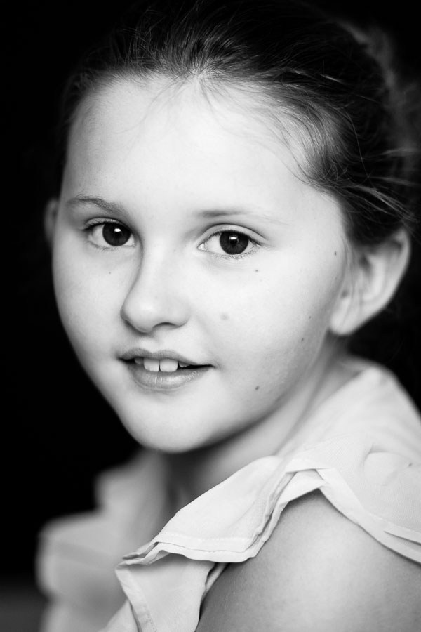 Low key girl portrait in black and white