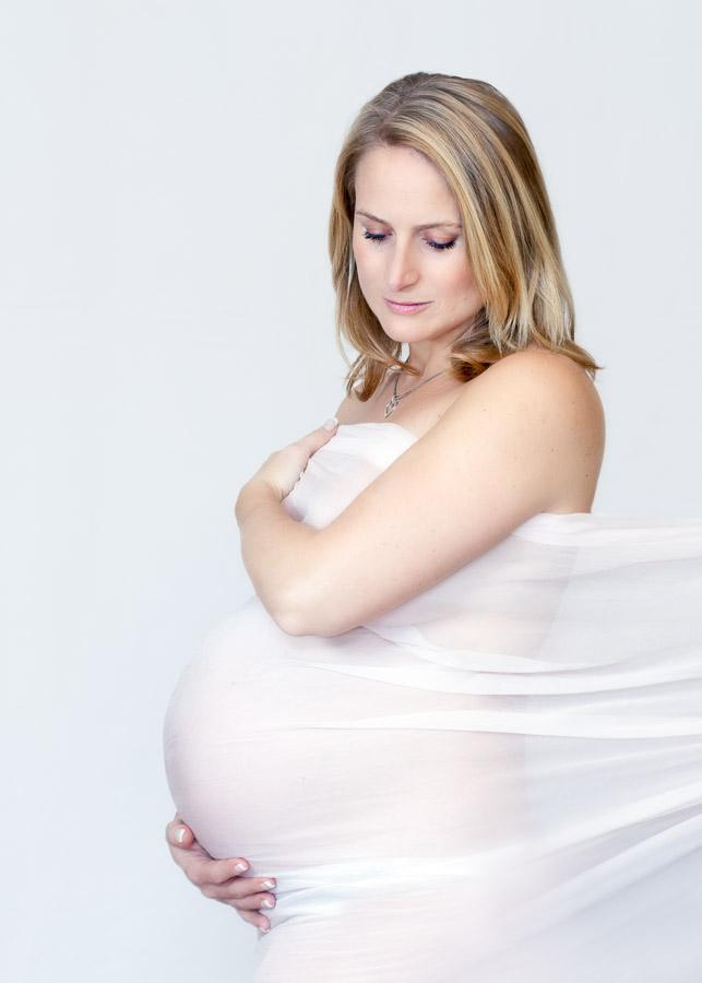 High key image of pregnant woman