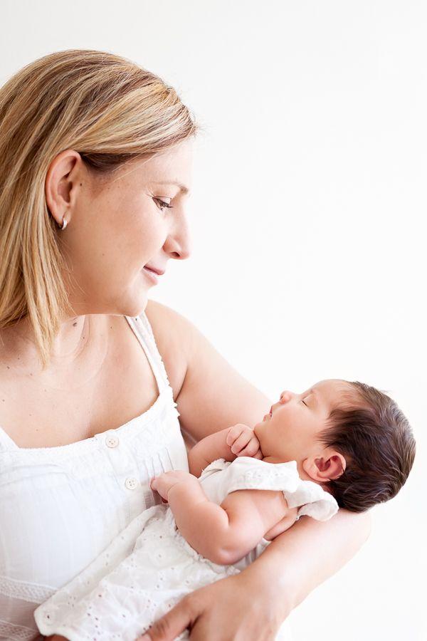 Mum looking at newborn baby girl