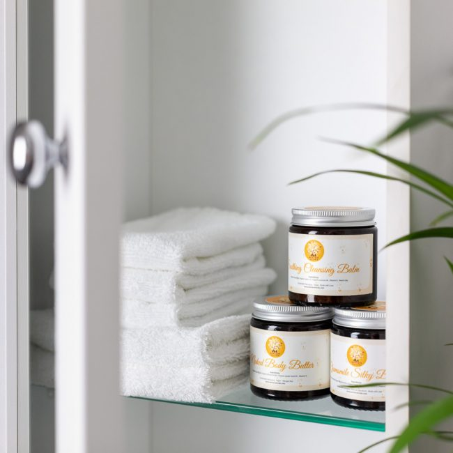 Natural body butter in bathroom cabinet